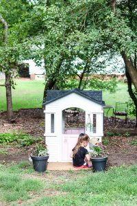 DIY Little Tikes playhouse makeover by Living Letter Home on a budget, with cute little details for our want to be gardener girl #modernfarmhouseplayhouse #playhousemakeover