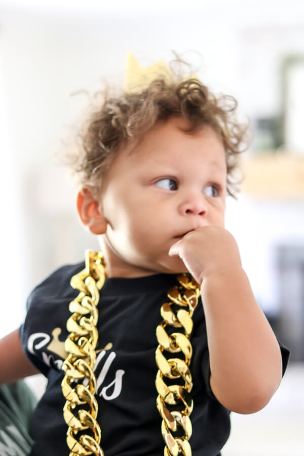 baby boy in gold chain and gold crown