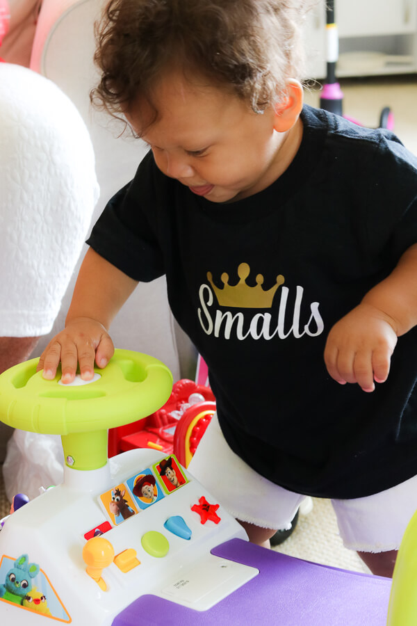 little boy wearing black smalls tshirt on it with a gold crown