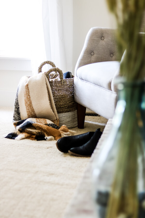 fall blanket in basket and shoes sitting in front of neutral chair