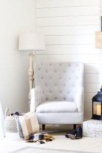 shiplap wall painted sherwin williams alabaster and white wingback arm chair