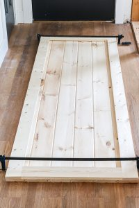 clamps holding together boards for DIY barn door