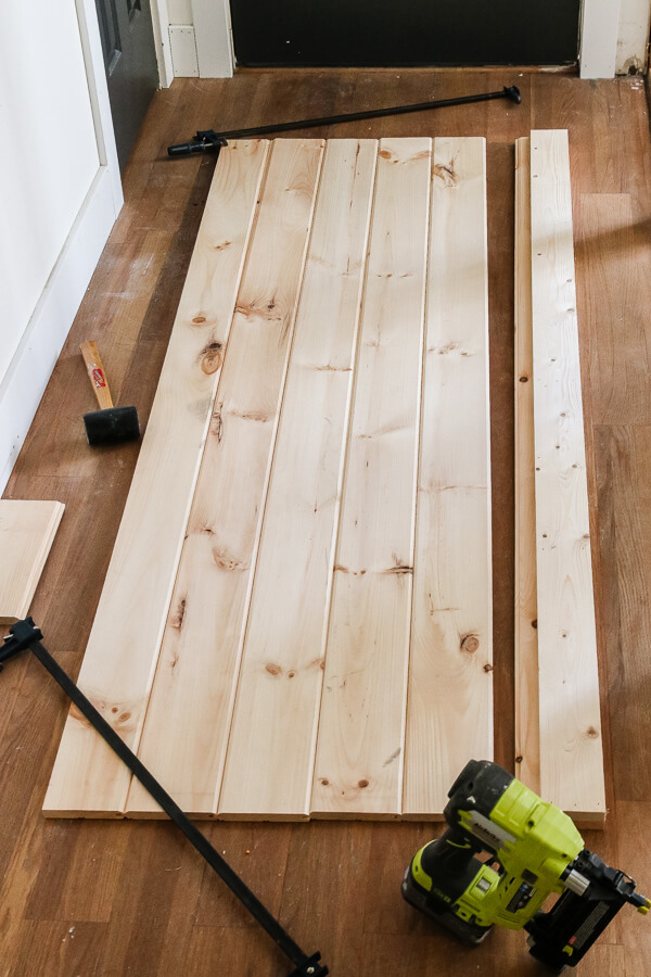 lumber laid out on hardwood floor with green Ryobi nail gun