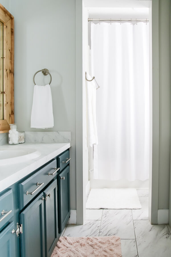 A stunning small master bathroom reveal. You won't believe the before!