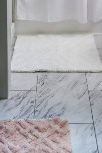 peel and stick marble look tile in bathroom