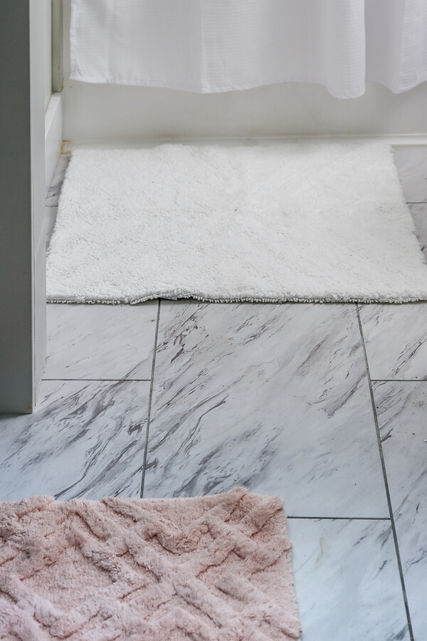 peel and stick marble look tile in bathroom