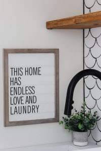 this home has endless love and laundry sign with Sherwin Williams Alabaster walls and mermaid tile