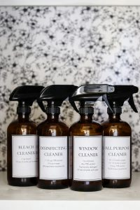 4 DIY cleaner bottles on a shelf