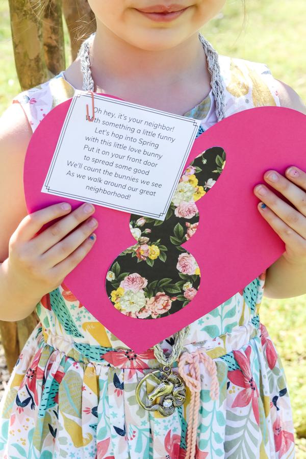 little girl holding love bunny neighbor gift neighborhood scavenger hunt