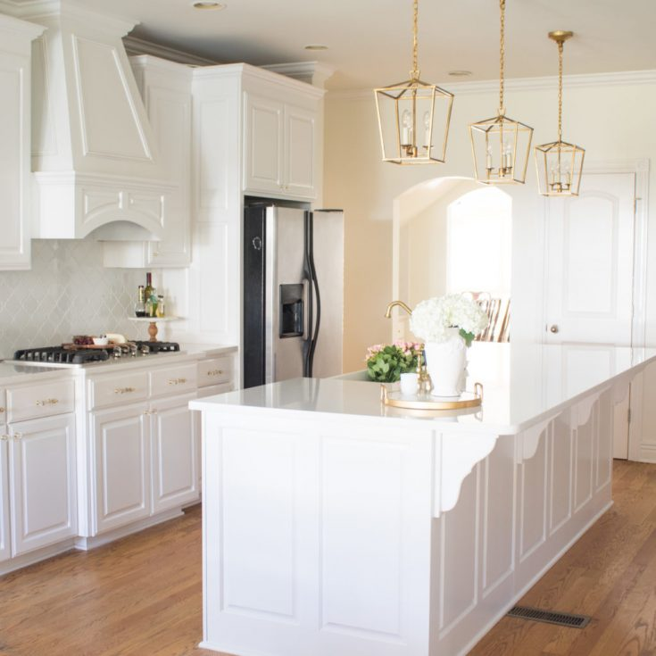 White Kitchen Remodel with Gold Accents