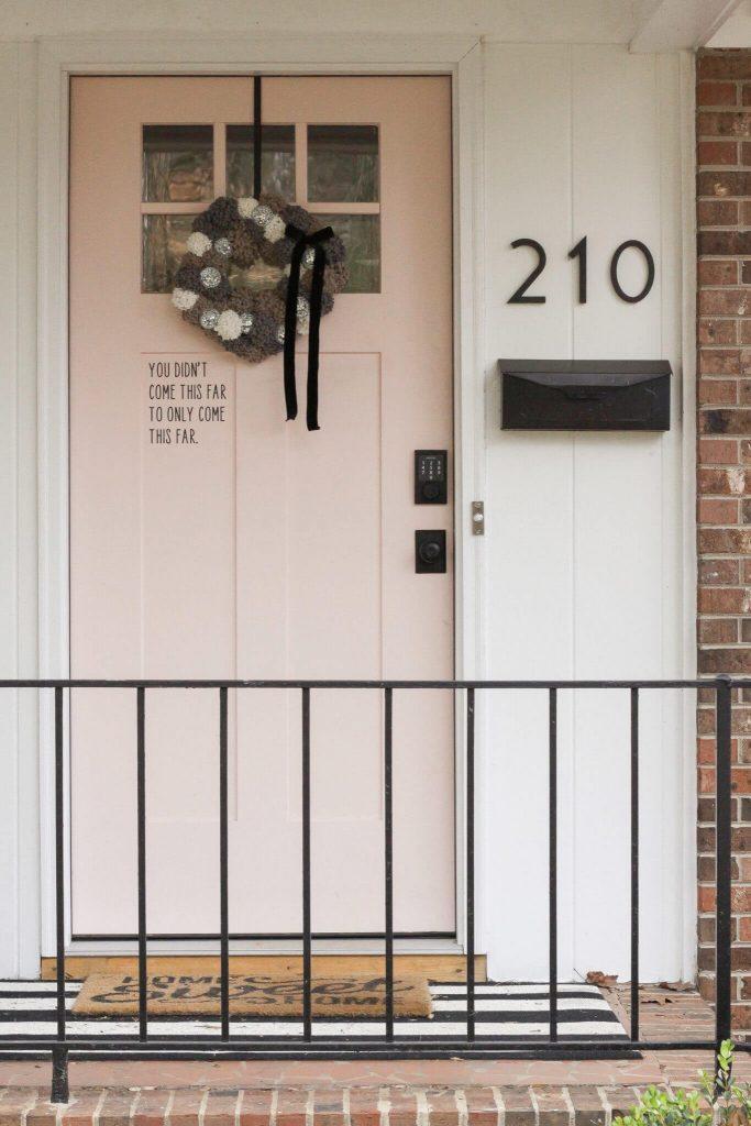 door with black quote on it