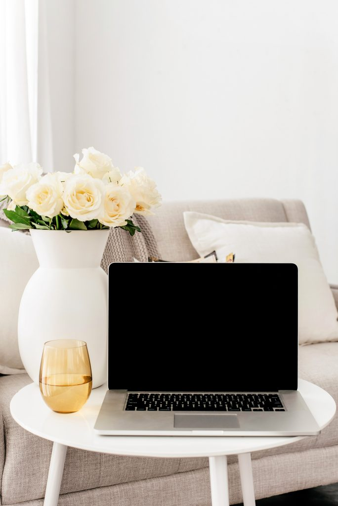 laptop and white roses