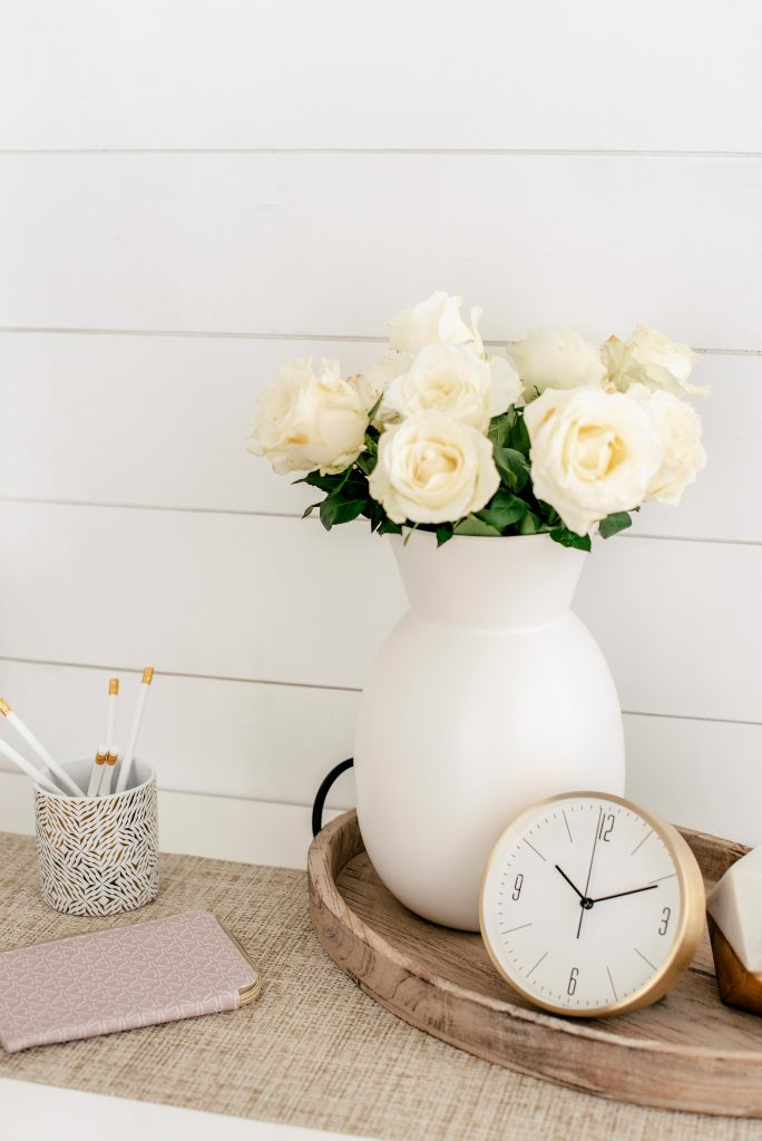 flowers and clock shiplap wall