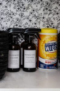 DIY homemade cleaners on shelf with Lysol wipes