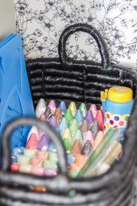 black storage basket with sidewalk chalk