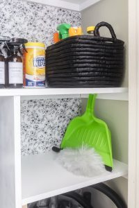 storage shelf with duster and dust pan