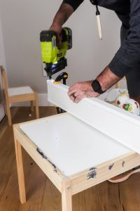using a nail gun to make a header for craftsman style window trim