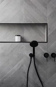 masculine gray chevron tile in bathroom with matte black fixtures