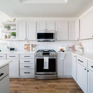 herringbone white tile backsplash in kitchen