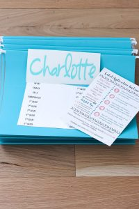 teal file folders with labels