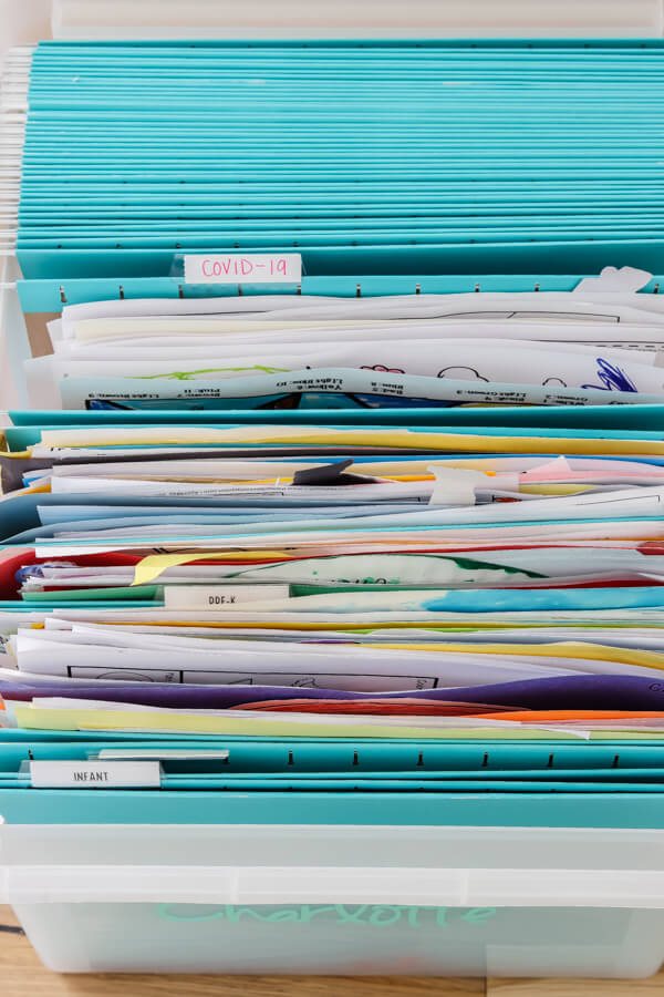 file folders with kid's school papers