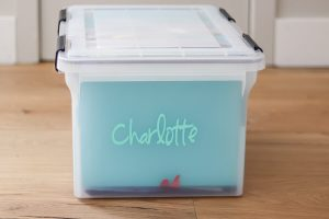 clear file bin with Charlotte on it