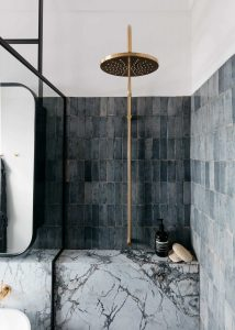 dark and moody bathroom with blue vertical stacked bond tile