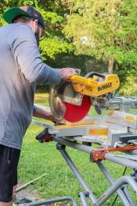 man using table saw