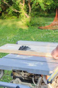 table saw cutting wood