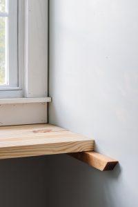 wood desk resting on 2x2 brackets