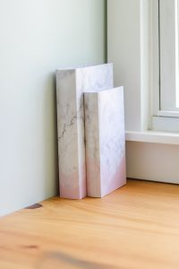2 marble and pink storage books