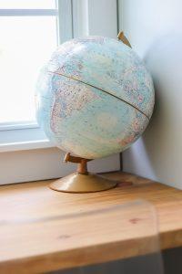 globe on wood desk