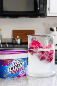 cloth paper towels in glass container of water and OxyCLean