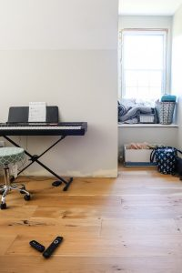 electric piano and window seat