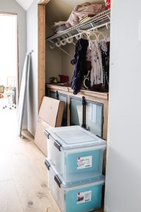 hall closet with wood vanity inside
