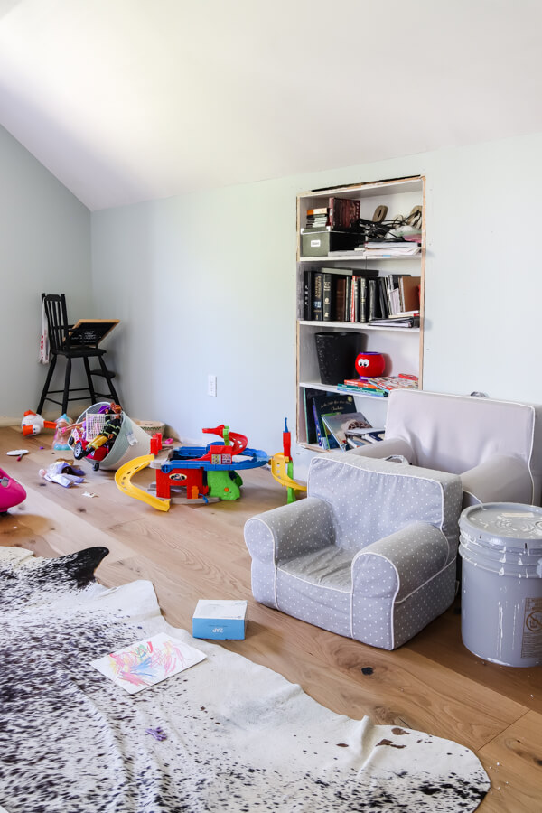 messy playroom with bookshelf