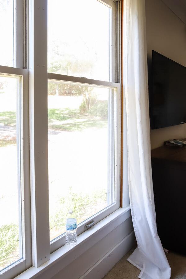 water bottle sitting on window sill