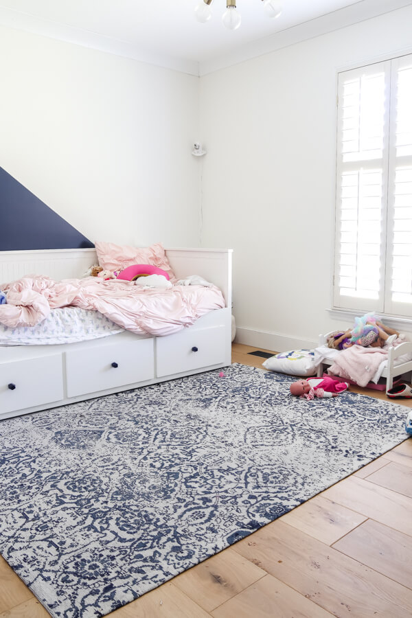 messy toddler girl bedroom with white ikea hemnes trundle bed