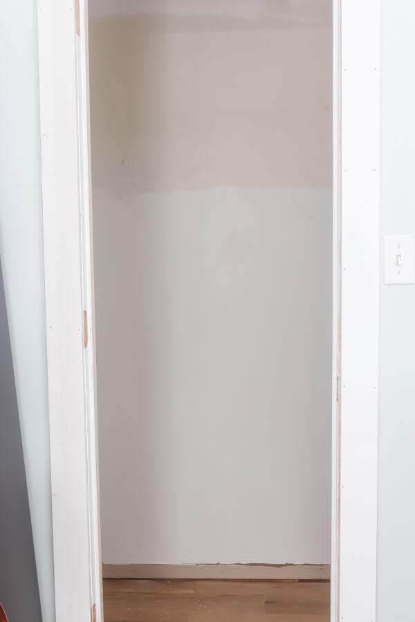empty tiny master closet