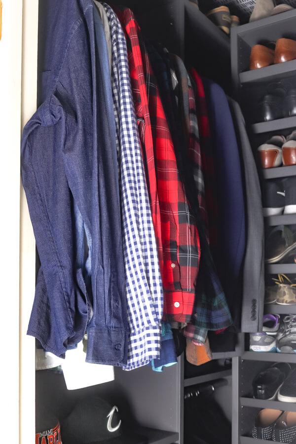 men's shirts hanging in the Ikea AURDAL closet