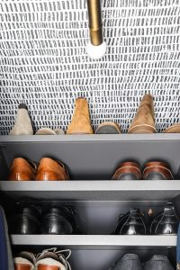 men's shoes stacked on gray Ikea AURDAL with wallpaper ceilings