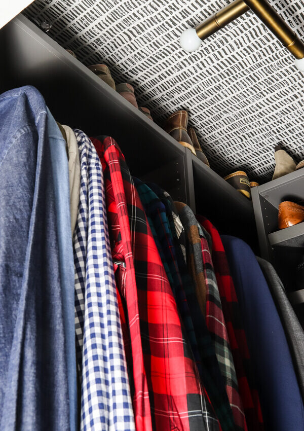 men's shirts hanging in gray Ikea AURDAL closet shelving unit