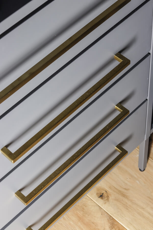 added long brass pulls to Ikea AURDAL closet system in gray