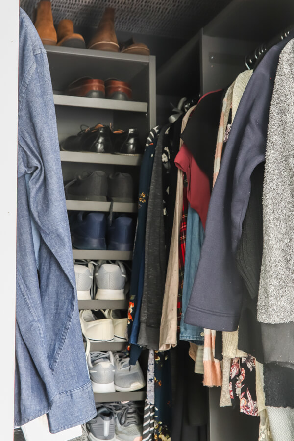 women's and men's clothes hanging in Ikea AURDAL closet in GRAY