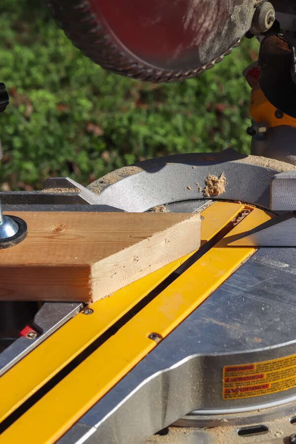 scrap piece of wood on table saw
