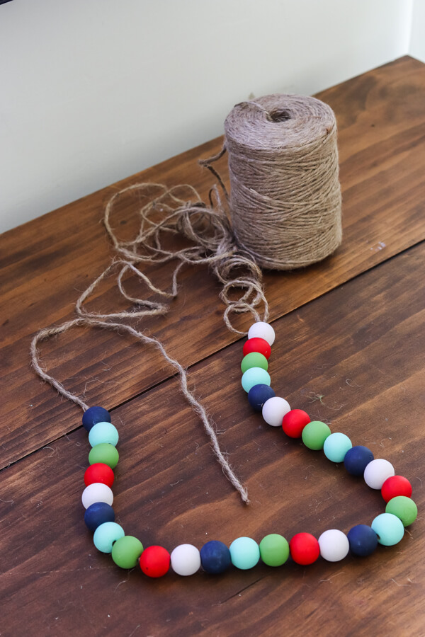 painted wood beads strung on twine