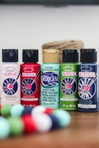 5 bottles of craft paint in various colors