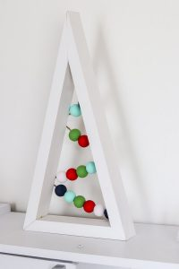 finished white DIY wooden christmas tree with colored craft beads