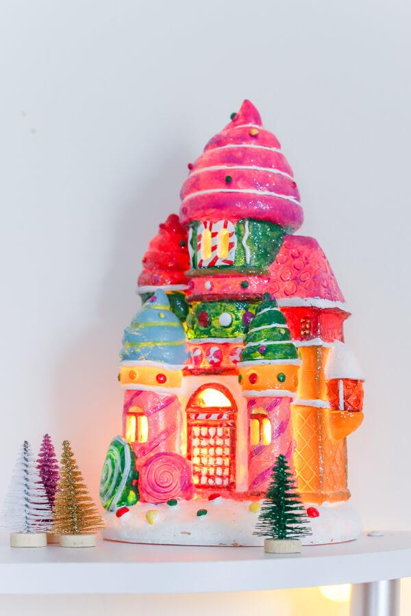 pink ceramic gingerbread house lit up