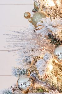 closeup of flocked christmas tree with silver pick